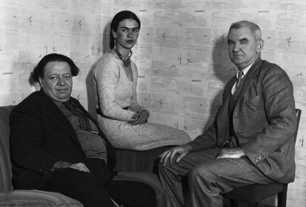 "13 Nov 1931, Manhattan, New York, New York, USA --- 11/13/31-New York: Mural artist Diego Rivera, outstanding leader of the recent ""Mexican Renaissance"" in painting, pictured with his wife artist Frida Kahlo, and Anson Conger Goodyear (right) President of the Museum of Modern Art, on arrival in New York, Nov. 13th., to begin work on a series of large murals for the exhibition of his work to be held at the Museum of Modern Art in December. --- Image by © Bettmann/CORBIS"