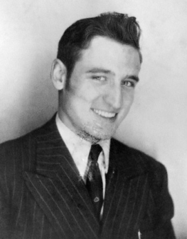 ca. 1946 --- Neal Cassady, the inspiration for the Dean Moriarty character in Jack Kerouac's novel On the Road, wears his first suit from a Chinatown tailor. --- Image by © Allen Ginsberg/CORBIS